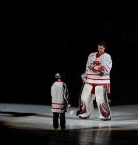 December 2008 - Jeremie DuPont greets the lucky young 'fan of the game.'