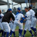 Jarrod Dyson (4) gets mobbed by his teammates after a 16th-inning triple gave the Chasers a 9-8 win.