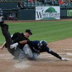 Gorkys Hernandez took out the home plate umpire on this play in New Orleans. PHOTO: Baseball Jan